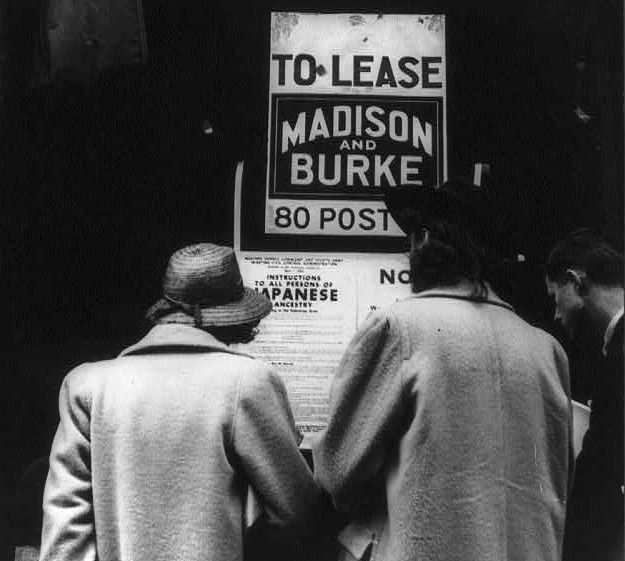 Shoppers reading exclusion order April 1942