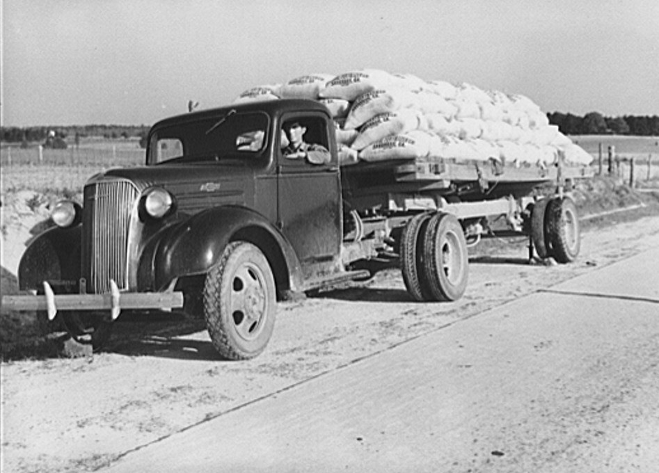 Truckload with fertilizer along highway. Greene County, Georgia