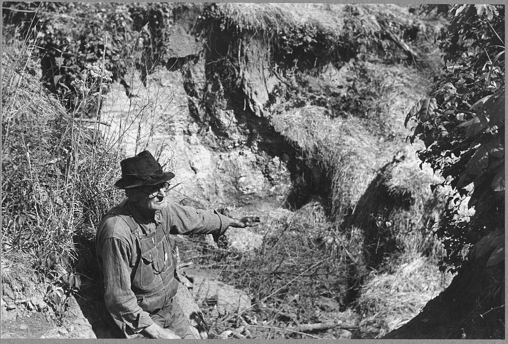 farmer pointed at eroded land m. post wolcott may 1939
