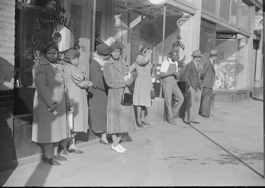 Domestic servants waiting for streetcar on way to work early in the morning. Mitchell Street, 3Atlanta, Georgia