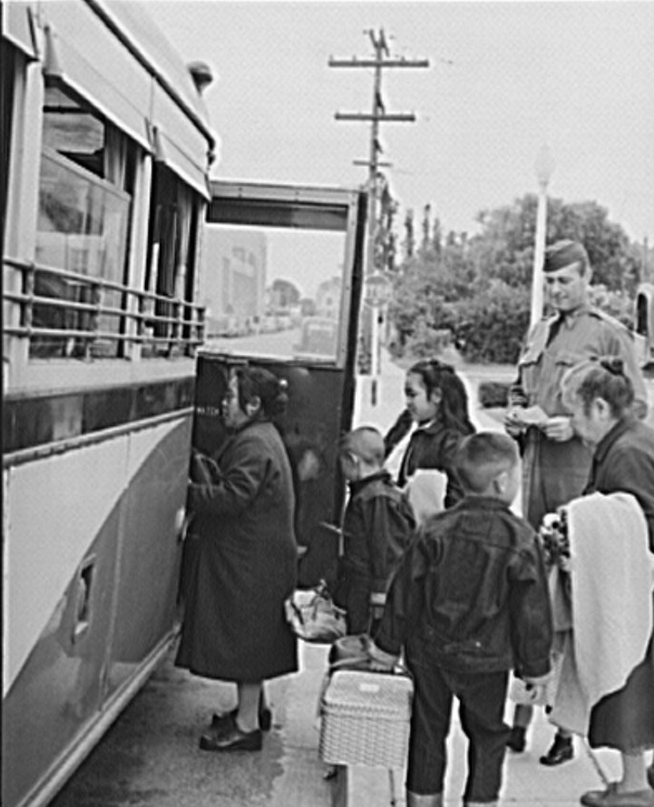 Japanese-Americans boarding bus for reception center