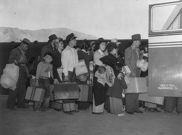 Japanese-Americans transferring from train to bus at Lone Pine, California, bound for war relocation authority center at Manzanar