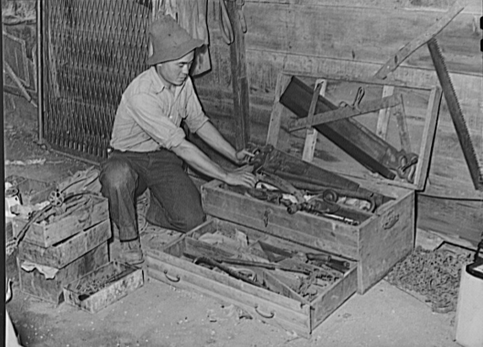 Japanese farmer packing up his tools before he is evacuated from West coast areas under United States Army war emergency order - used