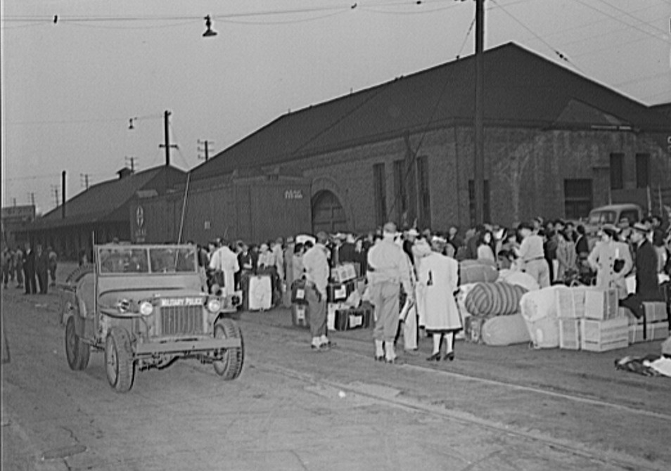 Japanese waiting for a train which will take them to Owens Valley during evacuation of Japanese-Americans from West coast under United States Army war emergency order