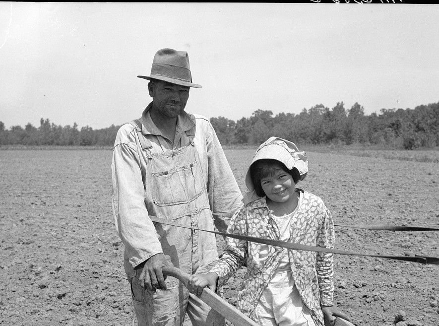 R.E. Sneed, rehabilitation client and eight year old daughter on cotton cultivator. Near Batesville, Arkansas May-June 1936