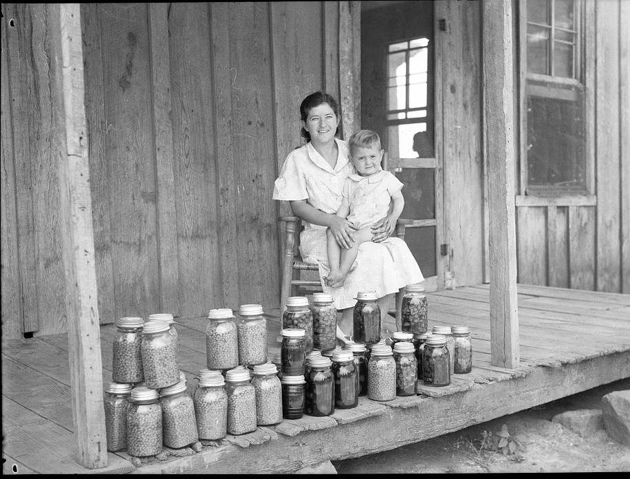 Rehabilitation client and food canned at the suggestion of Resettlement Administration rehabilitation supervisor. Near Batesville, Arkansas June 1936