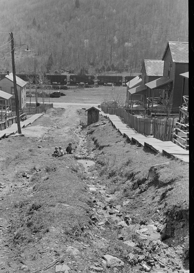 Children playing in street of company town, Kempton, West Virginia. Note open ditches kempton, WV