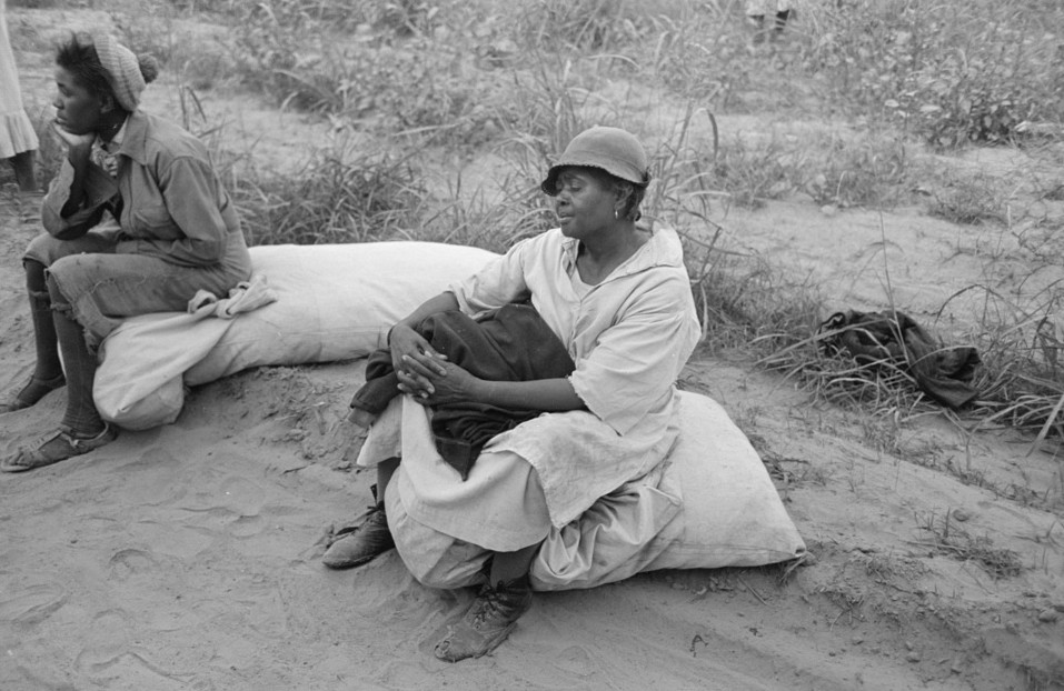 Cotton pickers resting while waiting to be paid. Lake Dick Project, Arkansas
