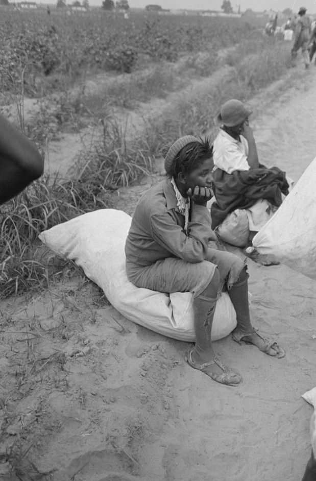 Cotton pickers resting while waiting to be paid3. Lake Dick Project, Arkansas