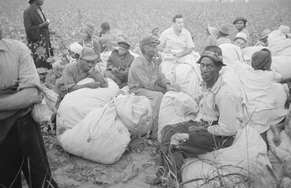Day laborers, cotton pickers, waiting to be paid off at end of day's work. Lake Dick Project, Arkansas