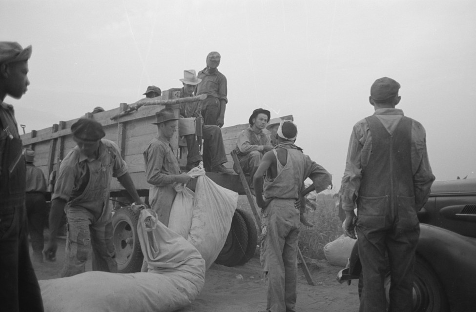 Day laborers, cotton pickers, waiting to be paid off at end of day's work2. Lake Dick Project, Arkansas