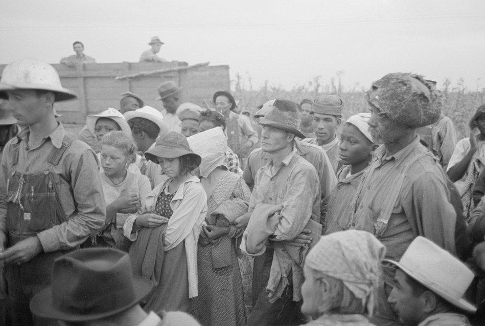 Day laborers, cotton pickers, waiting to be paid off at end of day's work6. Lake Dick Project, Arkansas