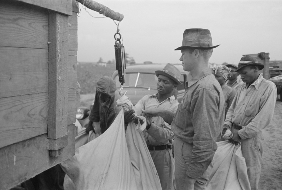 Day laborers, cotton pickers, waiting to be paid off at end of day's work8. Lake Dick Project, Arkansas