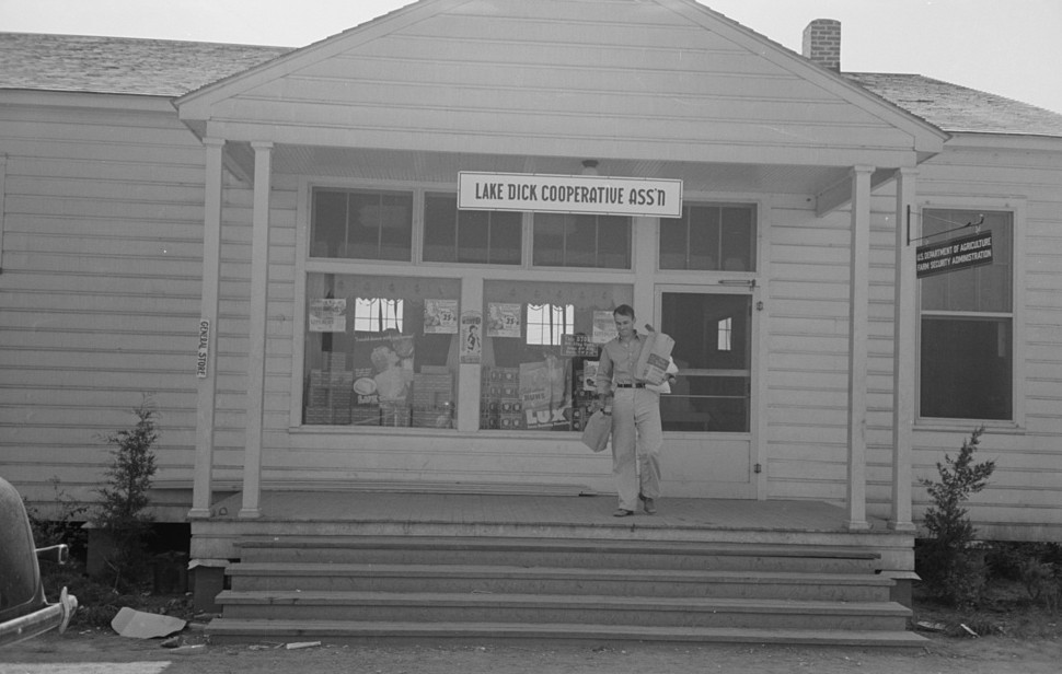 Farmer coming out of general store, Lake Dick Project, Arkansas by photographer Russell Lee September 1938