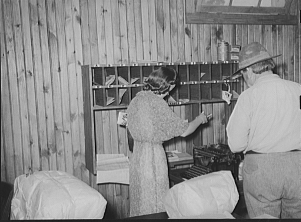 Getting the mail in cooperative store. Lake Dick, Arkansas