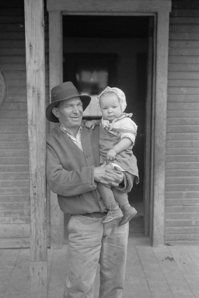 Italian coal miner with his grandchild, Kempton, West Virginia