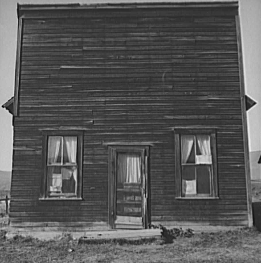Member of Ola self help sawmill co-op lives in what was once the Jacknife Saloon. This type building is characteristic of early Idaho. The stagecoach used to stop here