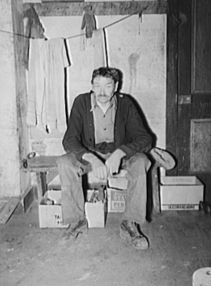 Old miner living in company house, rent free. He was injured while working in the mines several years ago, has been unable to work since. Company provides Kempton, West Virginia