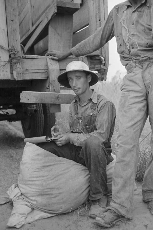 Recording weights of cotton picked by day laborers, Lake Dick Project, Arkansas