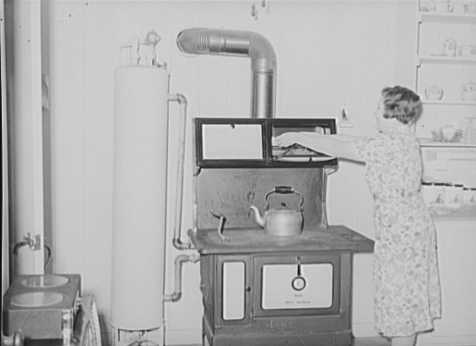 Stove and hot water boiler in farm home. Lake Dick Project, Arkansas