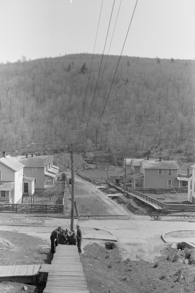 Striking coal miners sitting on the boardwalk, during May 1939 coal strike. Kempton, West Virginia