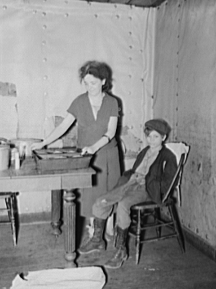 Wife and son of coal miner in kitchen of their home. Kempton, West Virginia
