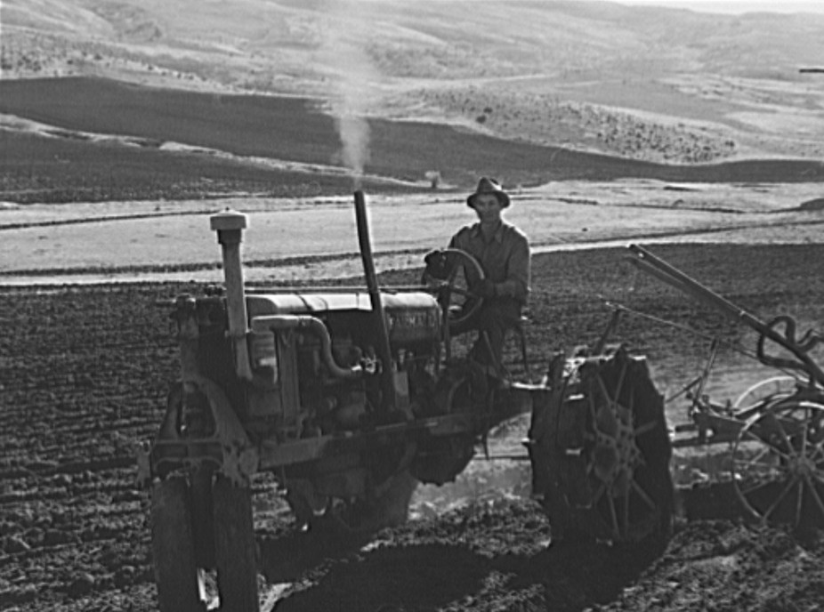 Young Idaho farmer plowing in the fall of the year while the other members of the Ola self-help sawmill co-op are working in the sawmill. The tractor does work for five member families.
