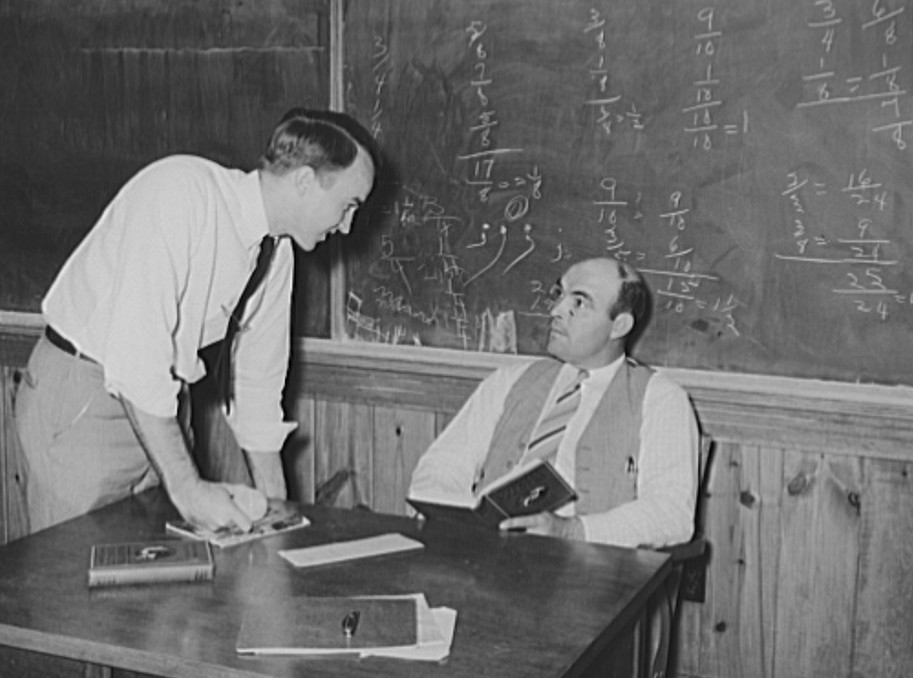 principal talks to teacher at lake dick oct. 1938