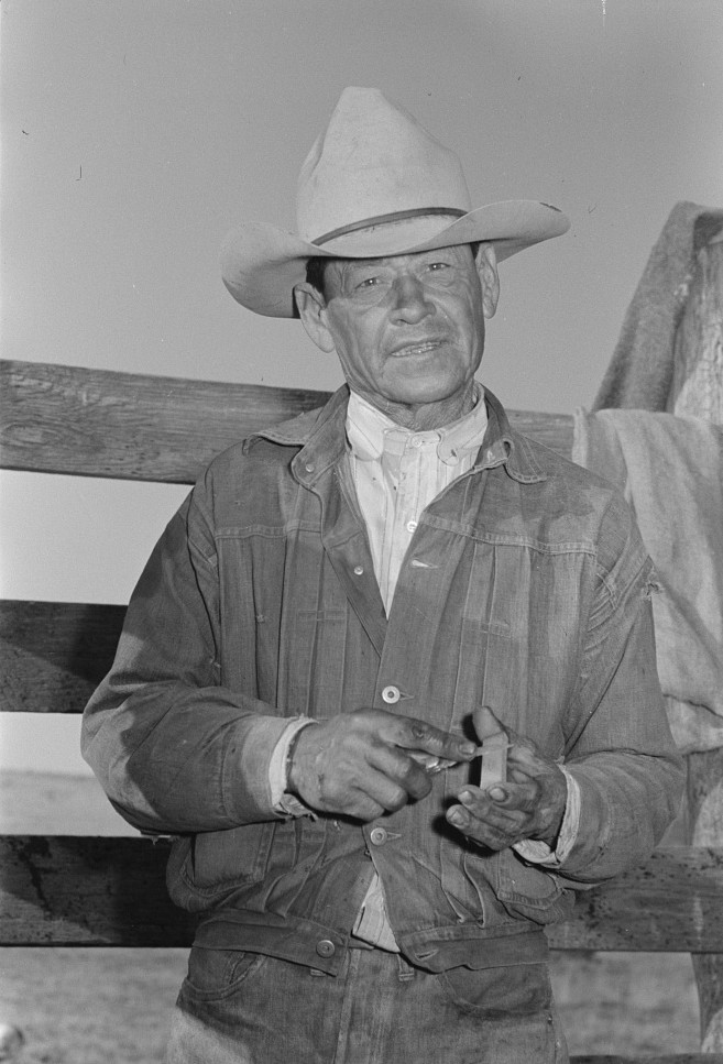 Mexican cowboy sharpening his knife. Roundup near Marfa, Texas photographer Russell Lee May 1939