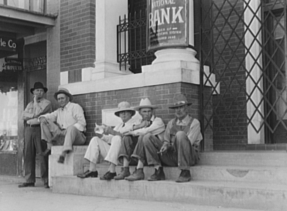 On the steps of the bank in the public square. Memphis, Texas by photographer Dorothea Lange June 1937