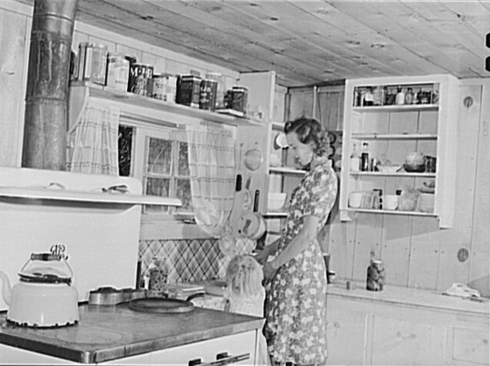 Wife and child of a member in the kitchen of their home