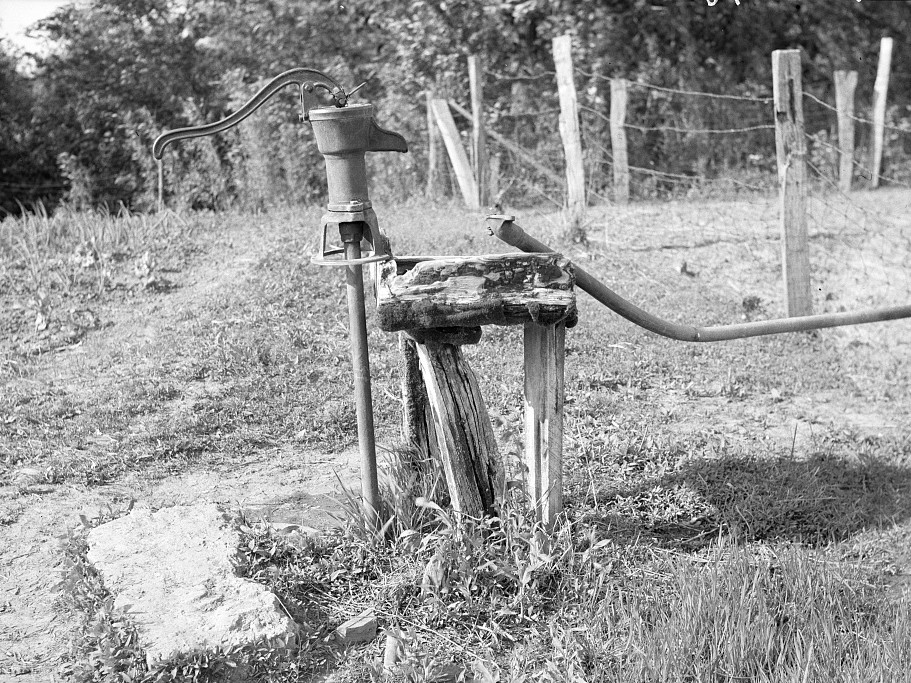 A sharecropper's setup for watering stock. Mississippi County, Missouri by Carl Mydans May 1936