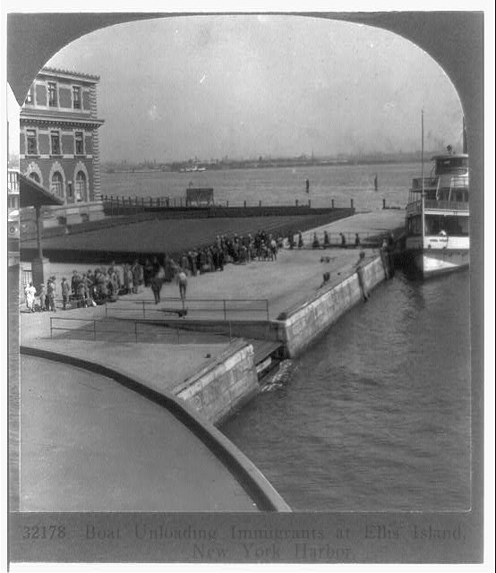 Boat unloading immigrants at Ellis Island, New York harbor Keystone View Co. 1928