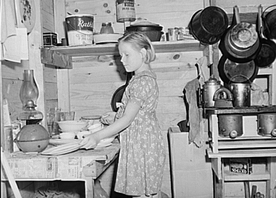 Daughter of migrant fruit worker in cabin (one room) which rents for one dollar and seventy-five cents a week. Berrien County, Michigan 1940