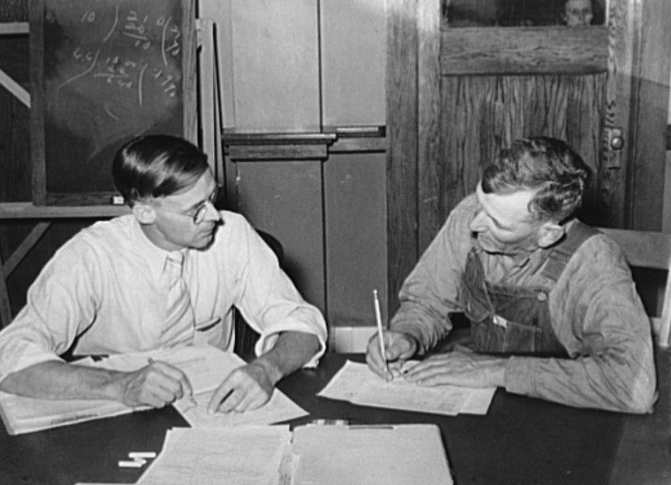 FSA (Farm Security Administration) supervisor conferring with client about farm plan. Sheridan County, Kansas russell lee 1939