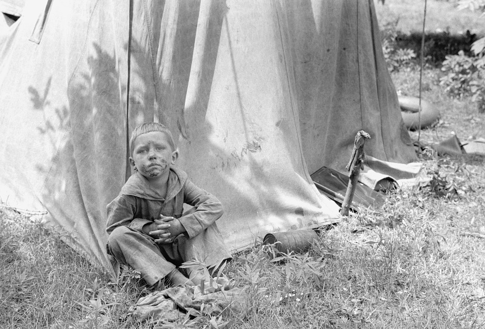 Migrant child in front of tent home, Berrien County, Mich. 1940