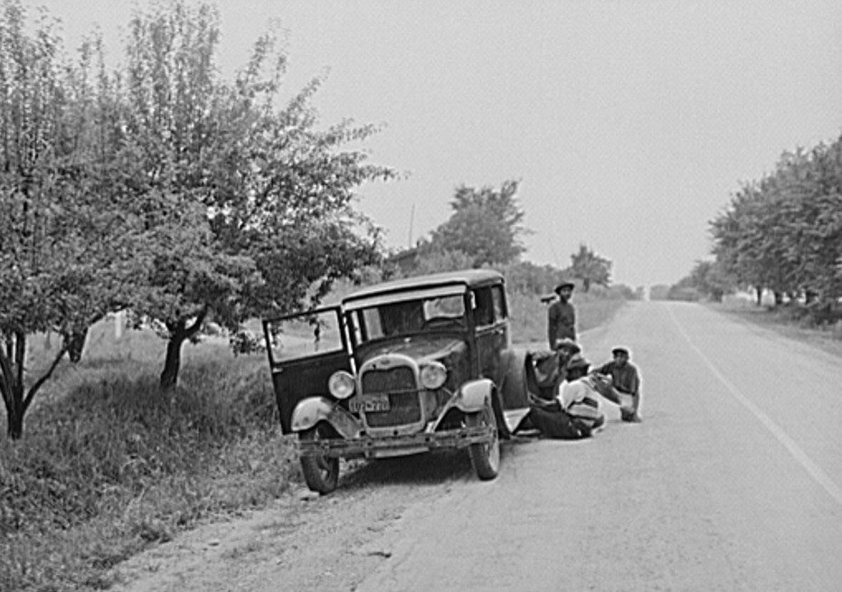 Migrant fruit workers from Louisiana fixing flat tire along the road. Berrien County, Michigan 1940