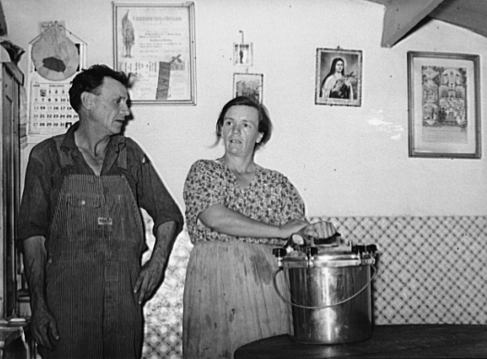 Mr. and Mrs. Schoenfeldt, FSA (Farm Security Administration) clients, in Sheridan County, Kansas, with pressure cooker of which she is very proud