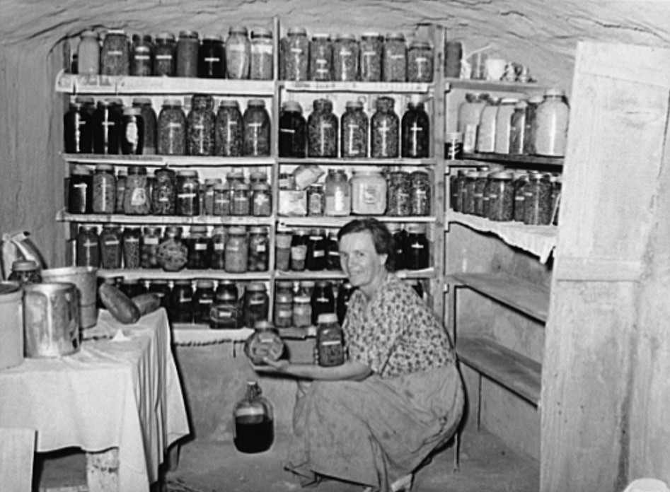 Mrs. Schoenfeldt, FSA (Farm Security Administration) client, in Sheridan County, Kansas, in fruit cellar russell lee 1939