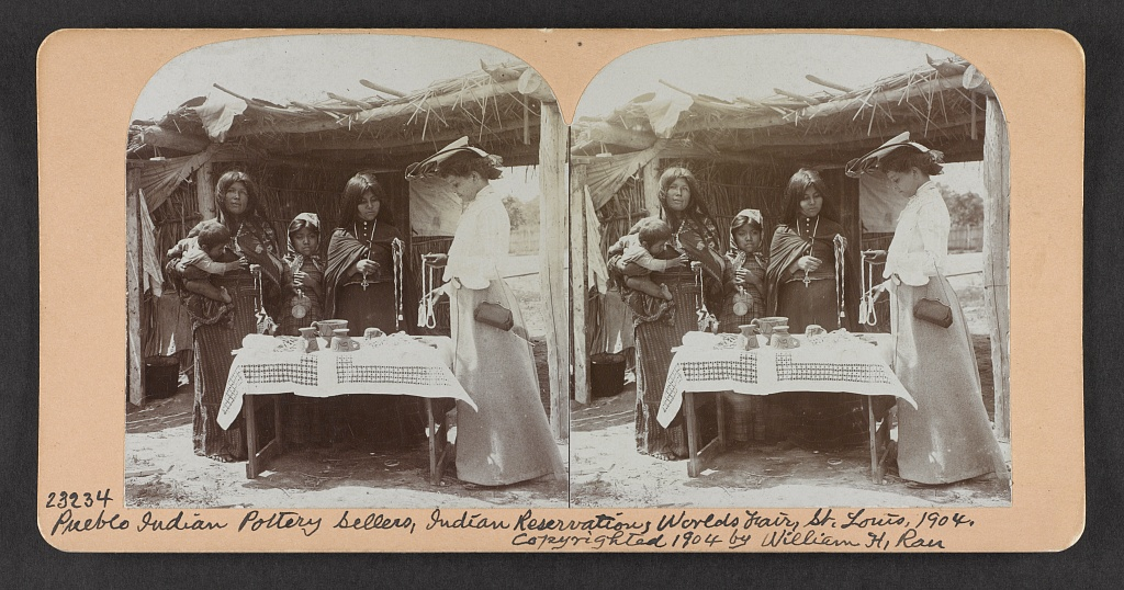Pueblo Indian pottery sellers, Indian reservation, World's Fair, St. Louis, 1904