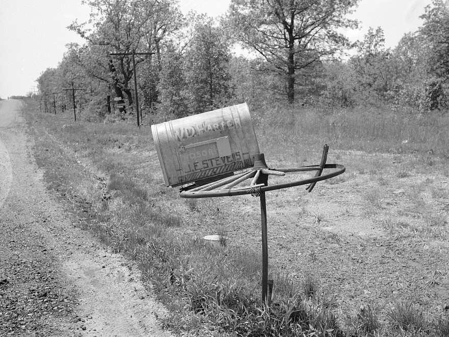 Rural mail box on old wagon wheel. Lake of the Ozarks, Missouri by photographer Carl Mydans May 1936