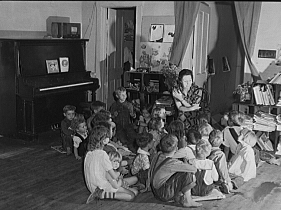 Teacher telling story to migrant children in nursery school run by Women's Council for Home Missions. Berrien County, Michigan 1940