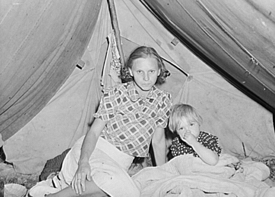 Wife and child of migrant fruit worker in their tent home. Berrien County, Michigan 1940