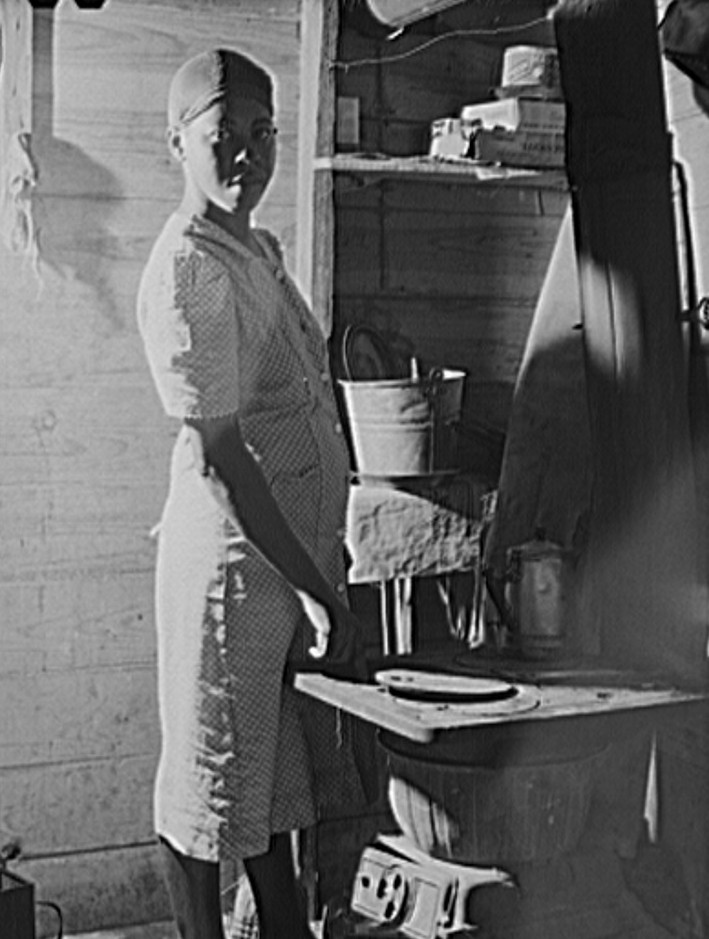 Wife of migrant fruit picker. They live in a one-room windowless shack on property of grower. Berrien County, Michigan 1940
