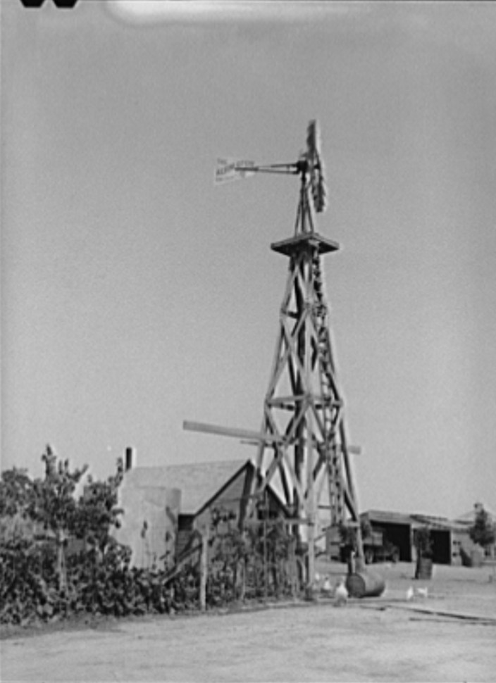 Windmill on farm of William Rall, FSA (Farm Security Administration) client in Sheridan County, Kansas russell lee 1939