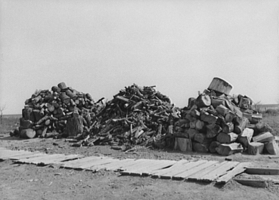 Woodpile on farmstead in Sheridan County, Kansas Russell Lee 1939