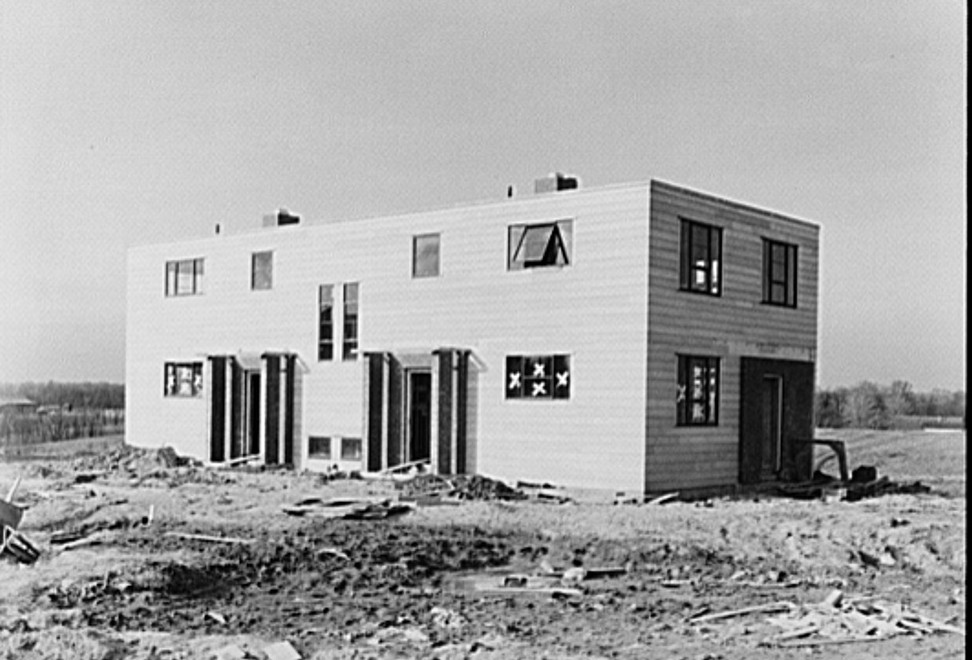 A two-family asbestos board house. Greenhills, Ohio feb. 1937 Russell Lee