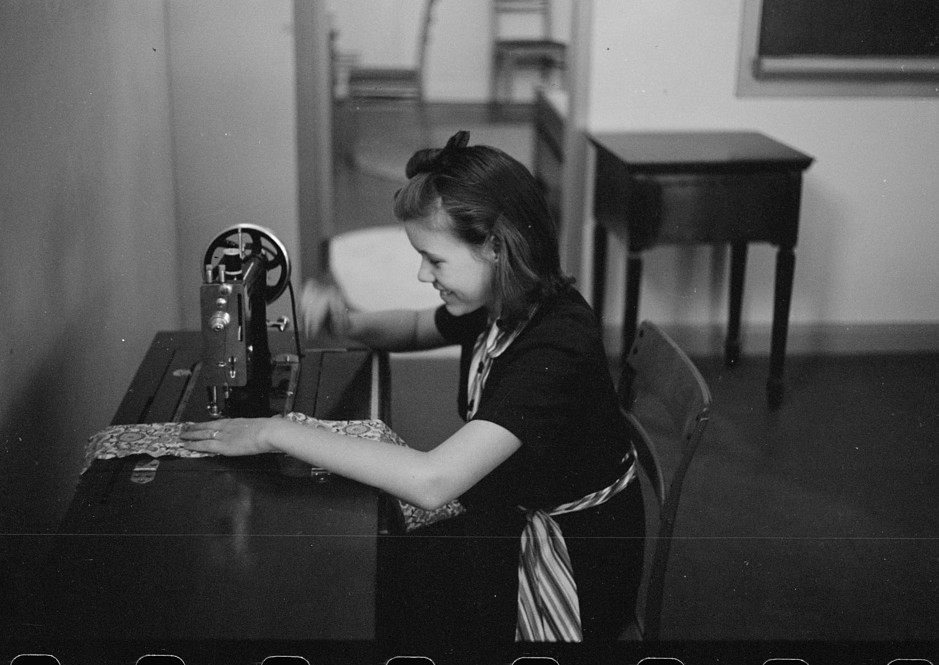 Girl sewing in Home economics class Ohio October 1938, by photographer John Vachon