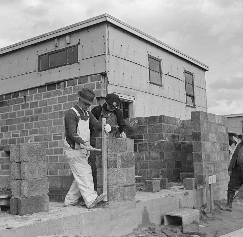 Houses under construction at the Greenhills project. Using the level to lay cinder blocks. Ohio feb 1937 russell lee