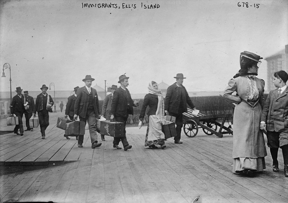 Immigrants carrying luggage